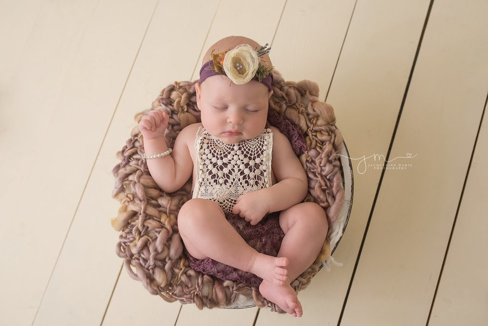 Columbus Ohio 3 month old baby girl wears plum and lace romper for milestone portrait session at Jacqueline Marie Photography