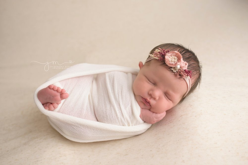 newborn baby swaddled for portrait in Columbus Ohio photography studio