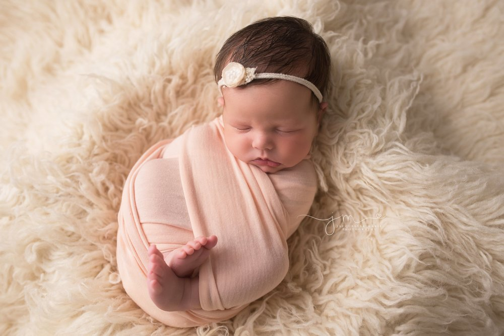 Columbus OH newborn baby swaddled in pink wrap for newborn session