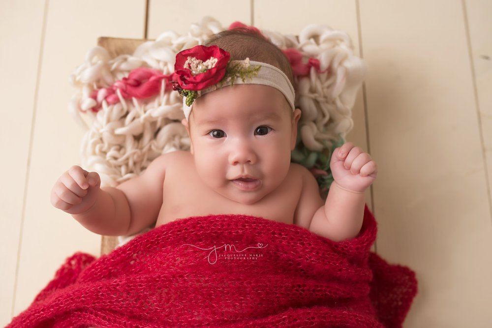Columbus Ohio baby photographer features 3 month old baby girl in Christmas headband for portrait session at Jacqueline Marie Photography studio