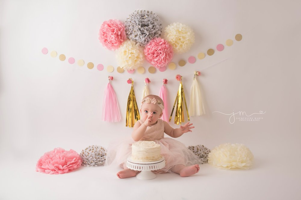 columbus ohio first birthday photographer features pink and gold custom cake smash photography for catherine