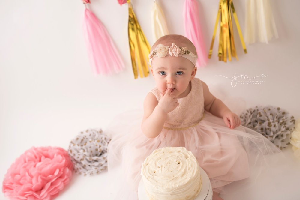 one year old baby girl celebrates first birthday with cake smash photography in columbus ohio