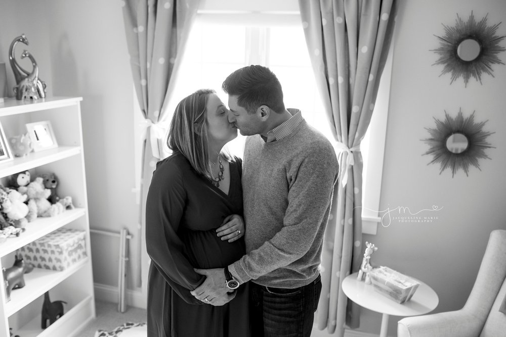 pregnancy picture features father holding mother's belly for maternity photography in columbus ohio