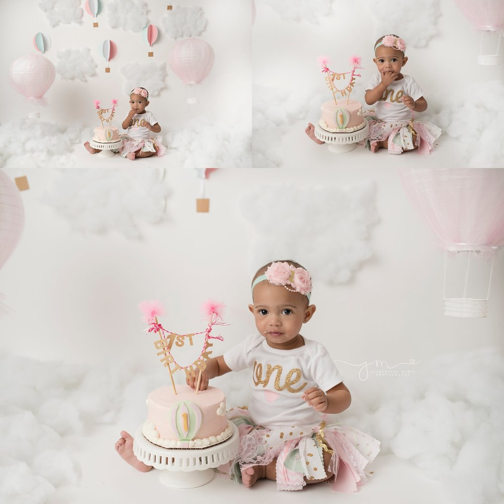 columbus ohio baby girl eats pink cake for cake smash photography pictures to celebrate first birthday at jacqueline marie photography studio