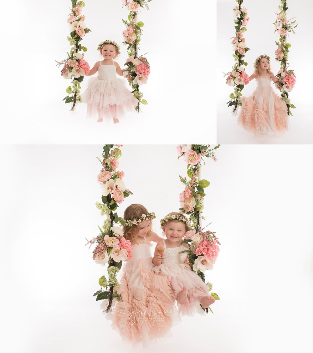 sibling photography featured in columbus ohio with sisters wearing pink dresses and matching floral crowns