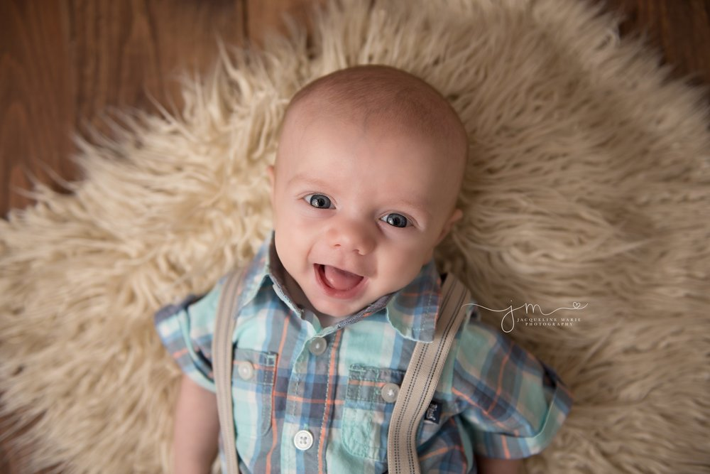 3 month old baby boy smiles for baby photography portraits in columbus ohio