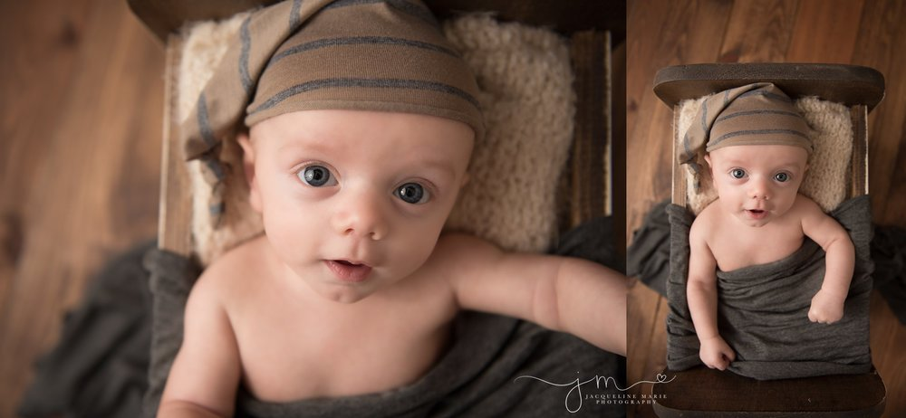 columbus ohio baby photographer features images of baby boy wearing striped hat while in wood bed for milestone photography pictures