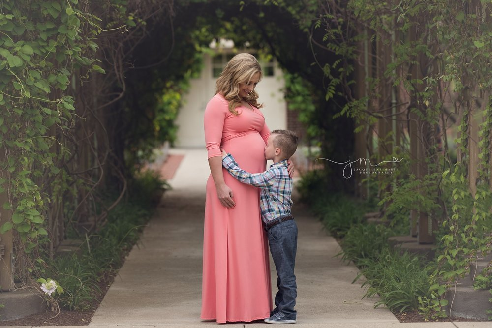 columbus ohio maternity and newborn photographer features image of mother and son kissing baby belly