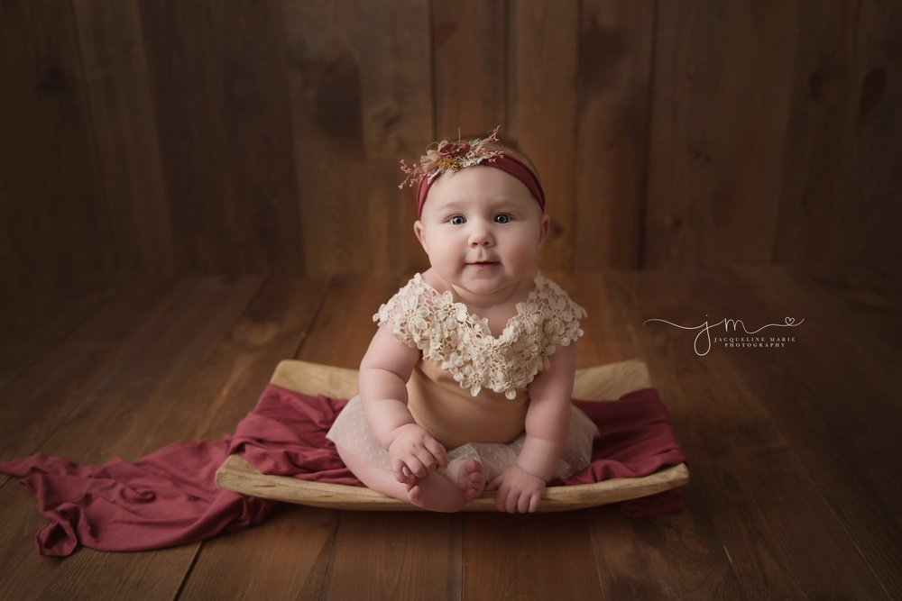 baby girl sophia wears tan and cream lace romper with matching headband for baby photography milestone pictures in columbus ohio