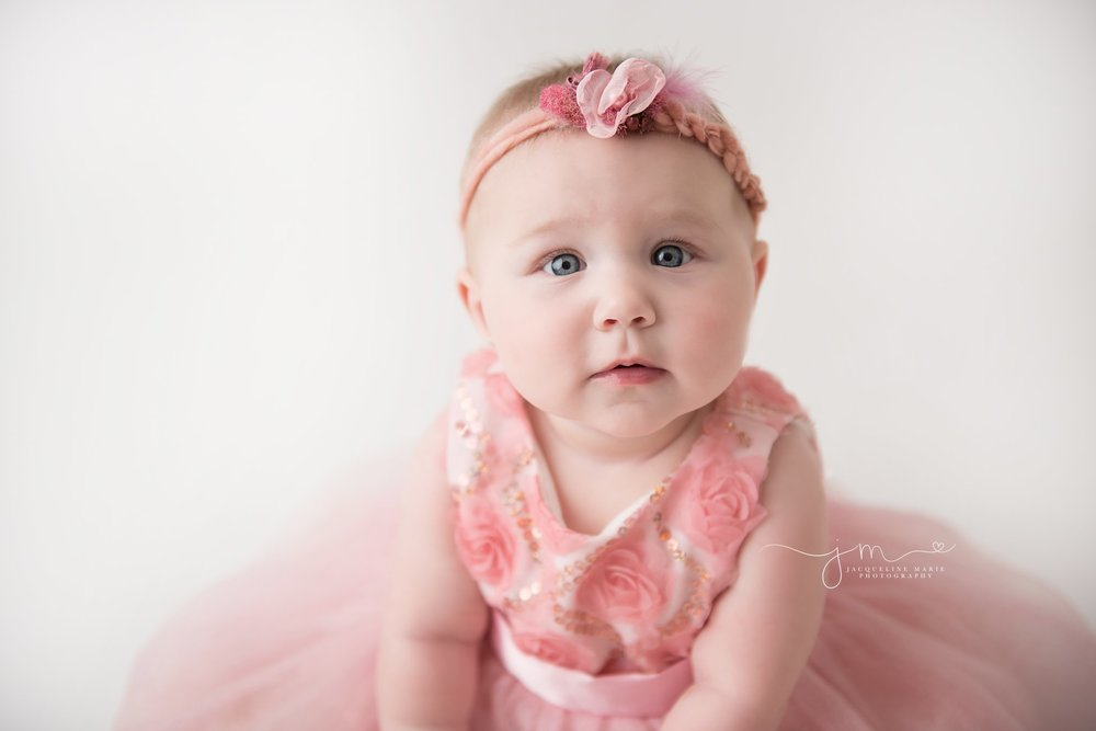 columbus ohio baby photographer features 6 month old sophia's bright blue eyes for milestone baby photography