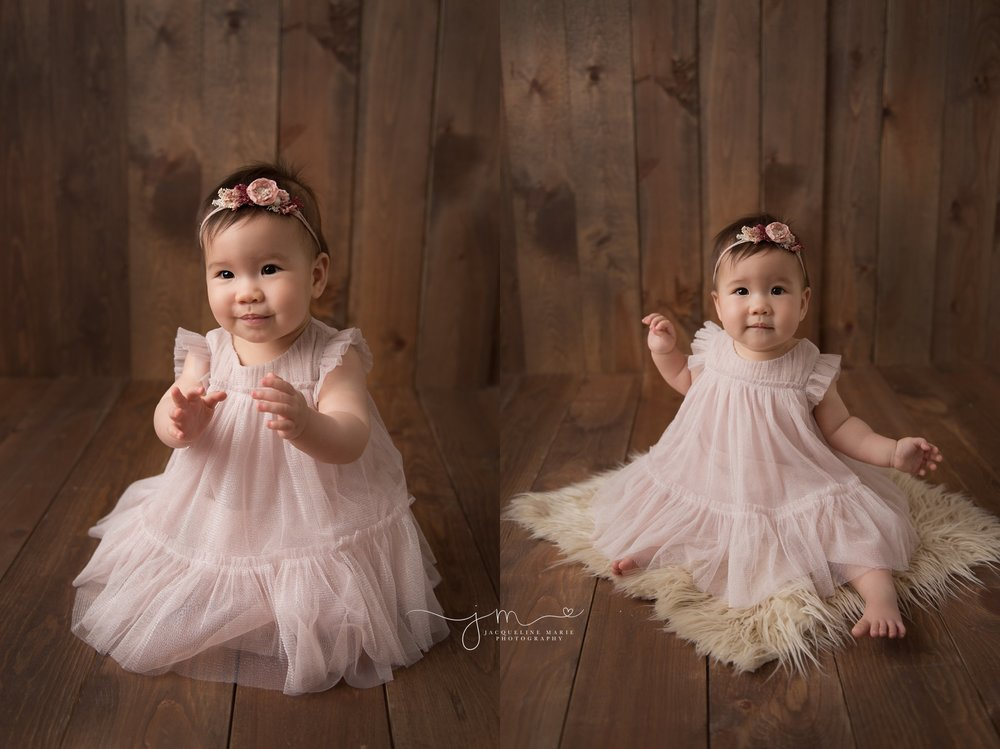 columbus ohio baby photographer features baby girl sitting up and clapping while smiling