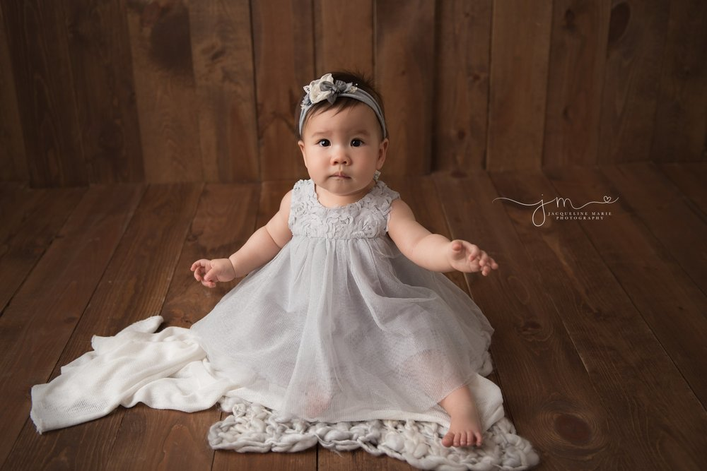 columbus ohio baby photographer features 9 month old baby girl for milestone pictures of baby wearing gray dress
