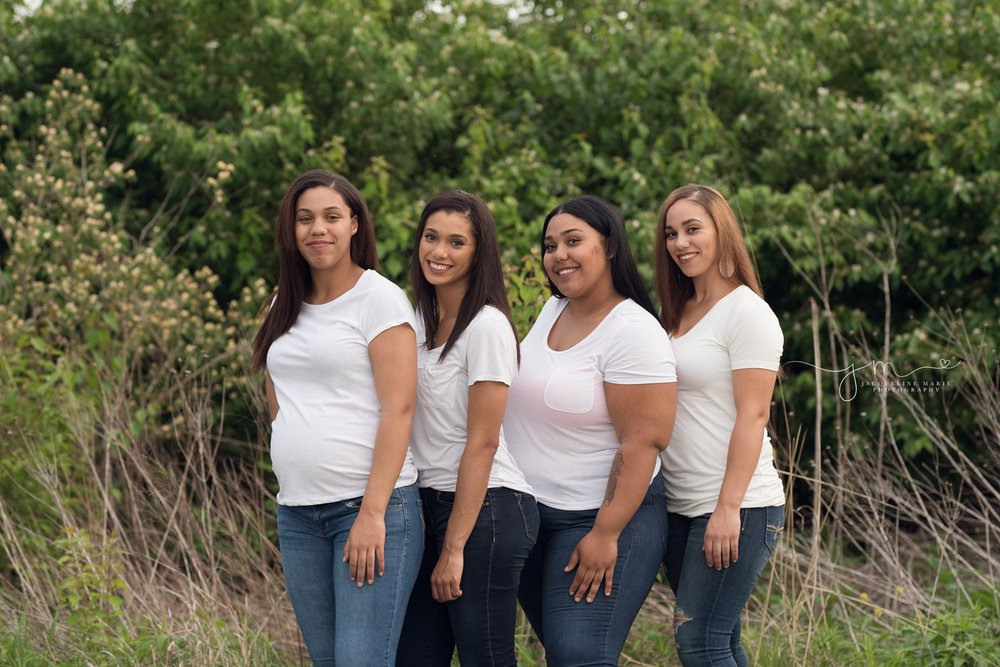 columbus ohio family photographer poses four sisters at park for family photography pictures
