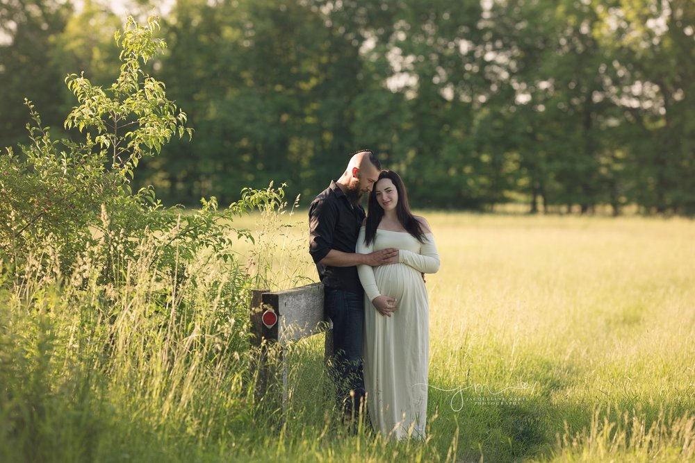 columbus ohio maternity photographer features mother wearing cream dress for pregnancy pictures