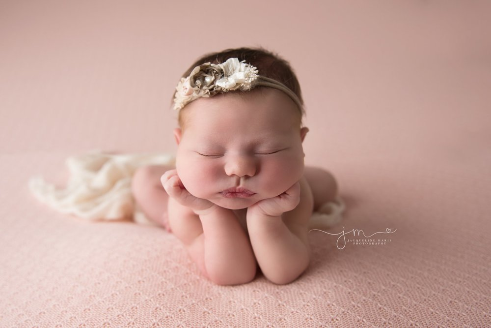 newborn photography portraits feature baby girl wearing pink and cream headband in Columbus ohio