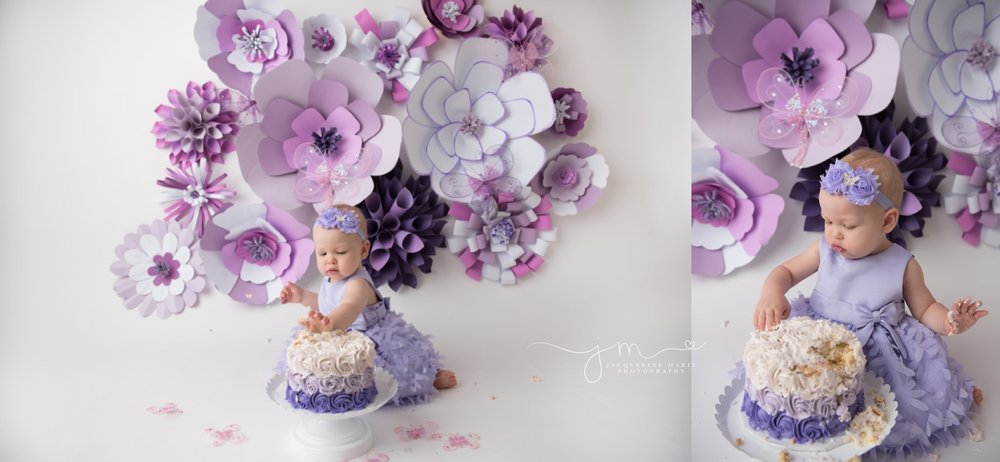 1 year old baby girl eats cake while wearing purple dress for first her first birthday cake smash pictures in columbus ohio