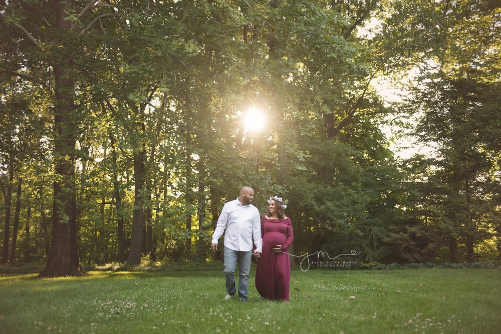 new parents to be walk and hold hands at sunset for maternity and pregnancy pictures in columbus ohio