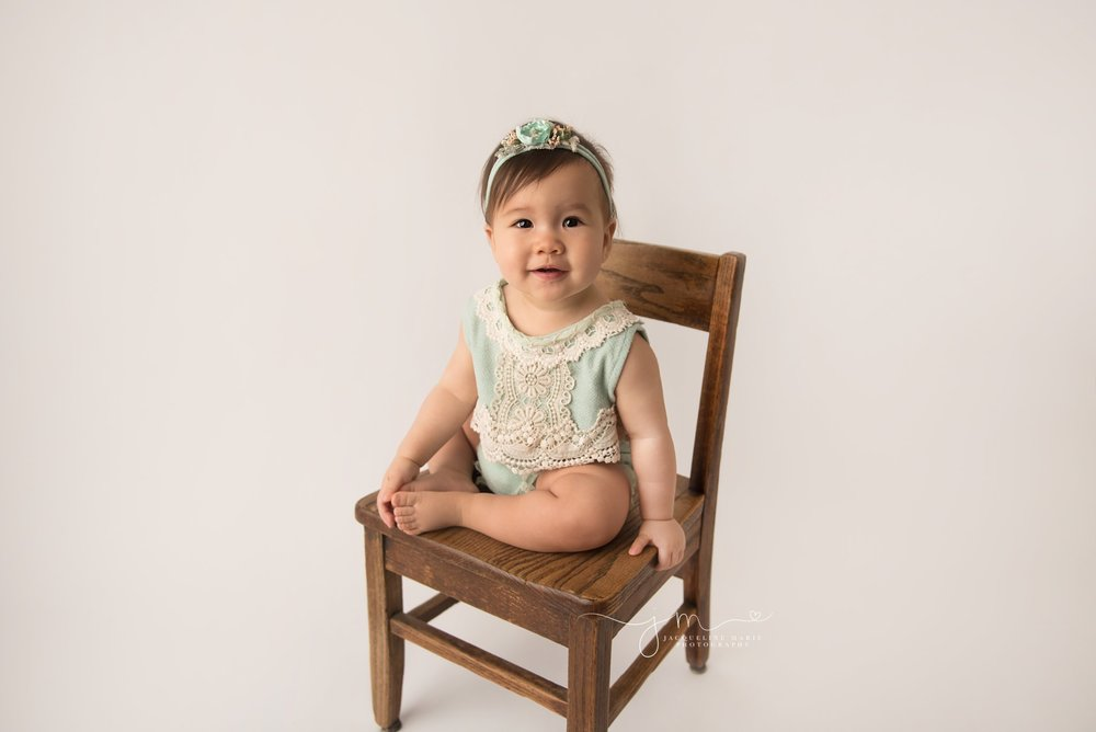 first birthday milestone photographer features little girl smiling in Columbus ohio