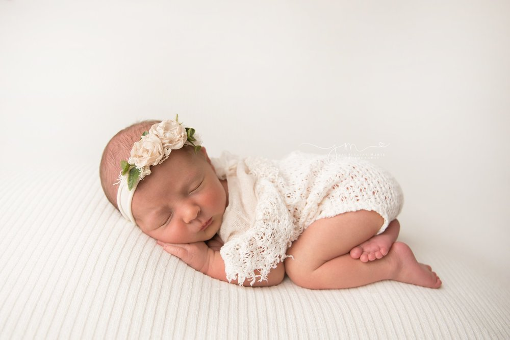 columbus ohio newborn photographer features images of baby girl in cream lace romper and toes resting on leg for newborn photography pictures