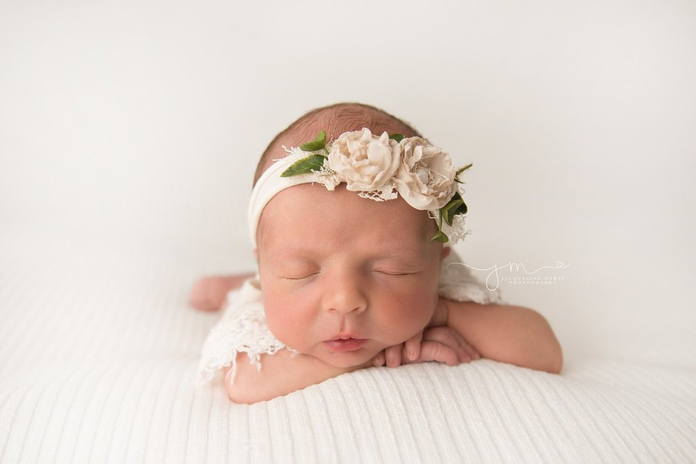 columbus ohio newborn baby girl rests her head on her hands while sleeping
