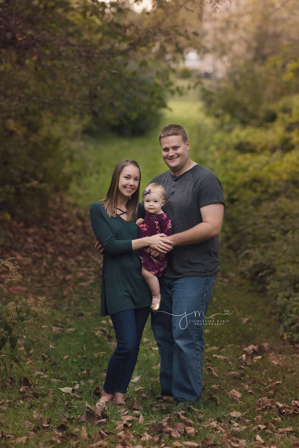 columbus ohio family photographer features mother and father holding one year daughter