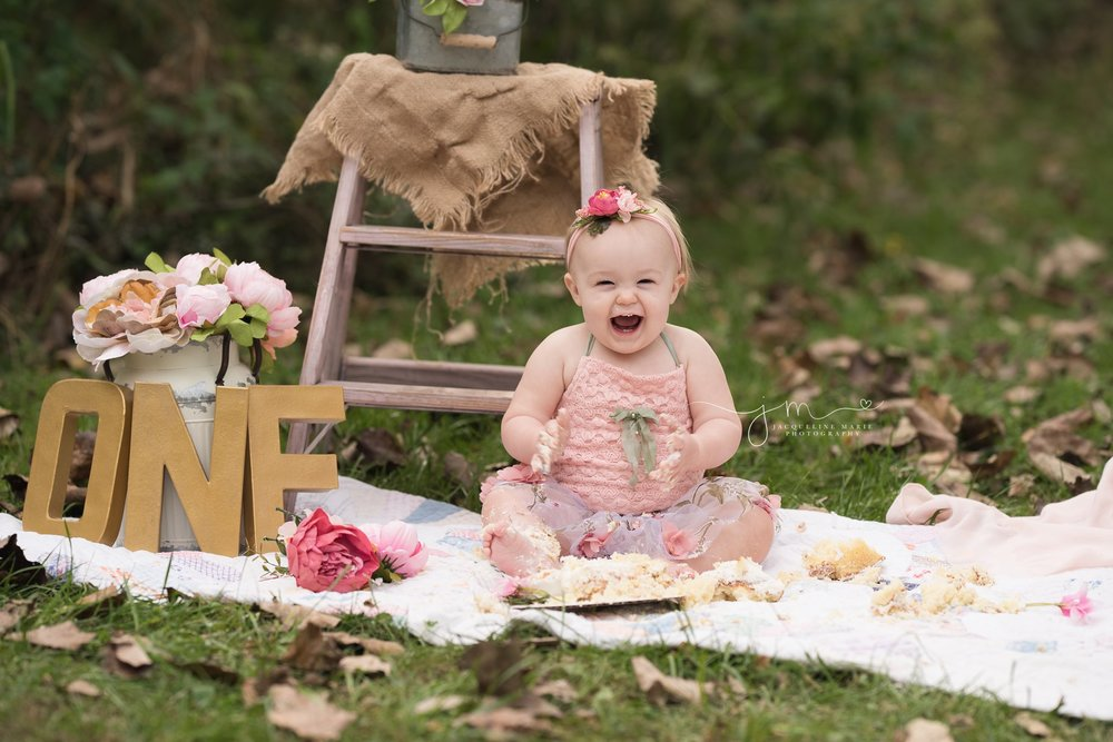 1 year old baby girl smiles and laughs for first birthday photos in columbus ohio
