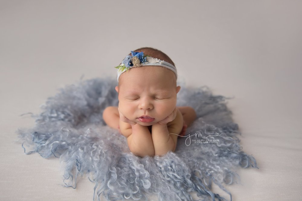 columbus ohio newborn photographer features image of baby girl in froggy pose on blue curly blanket