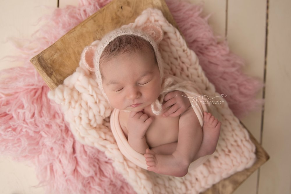 columbus ohio newborn baby girl wears pink teddy bear bonnet for newborn photography pictures