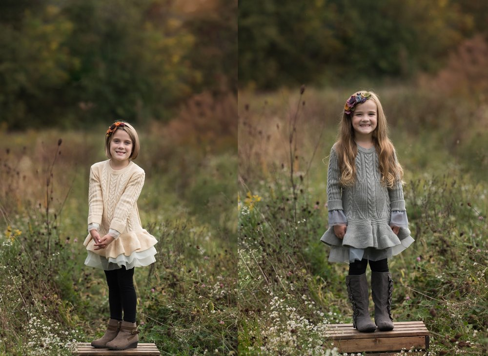 columbus ohio family photographer features images of sisters standing on wood box in tall field grass