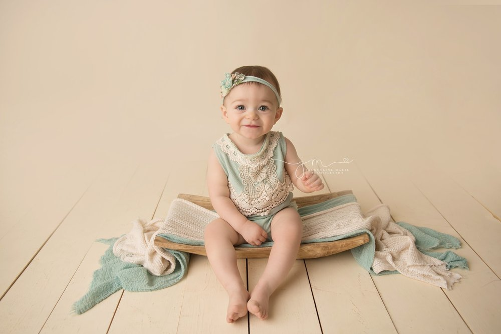columbus ohio baby girl wears mint green romper for first birthday milestone session