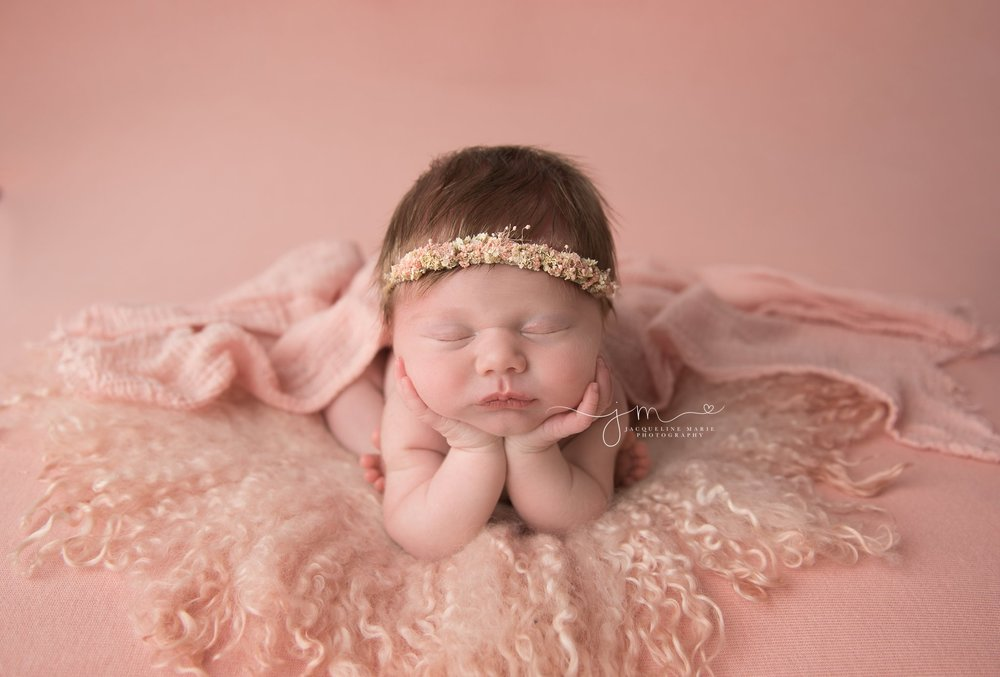 columbus ohio newborn baby girl wears pink floral crown for newborn portraits