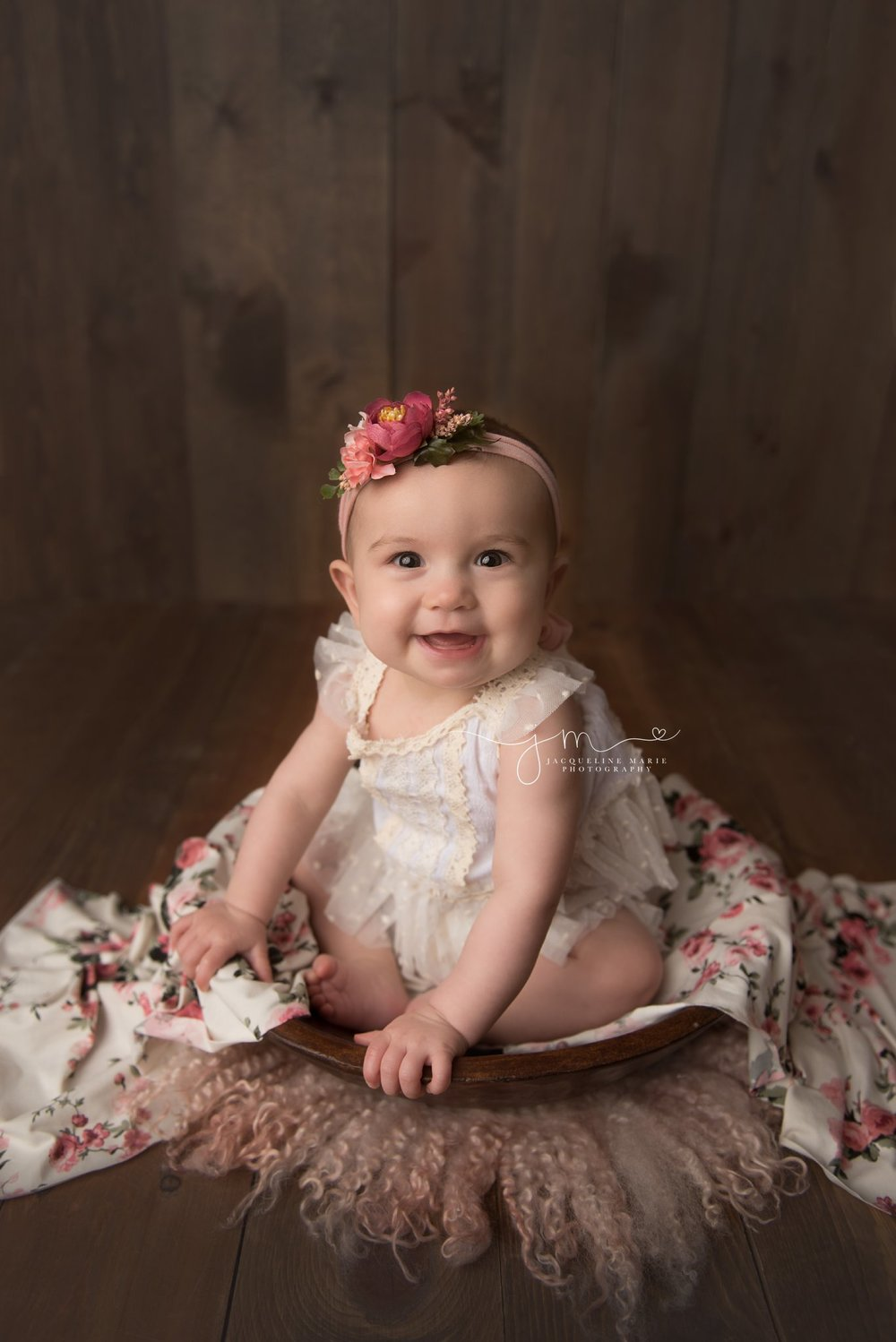 6 month baby wears cream lace romper for milestone pictures in columbus ohio