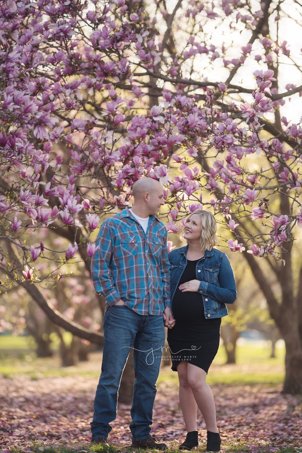 new parents to be hold hands for maternity photo session in columbus ohio
