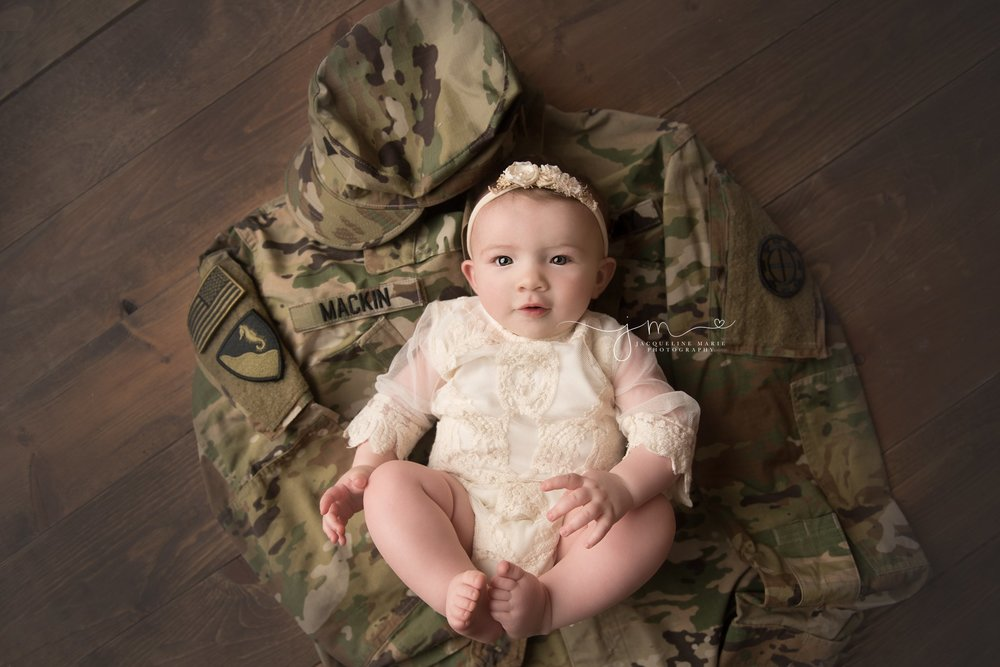 columbus ohio baby girl lays on her father's military jacket during his deployment