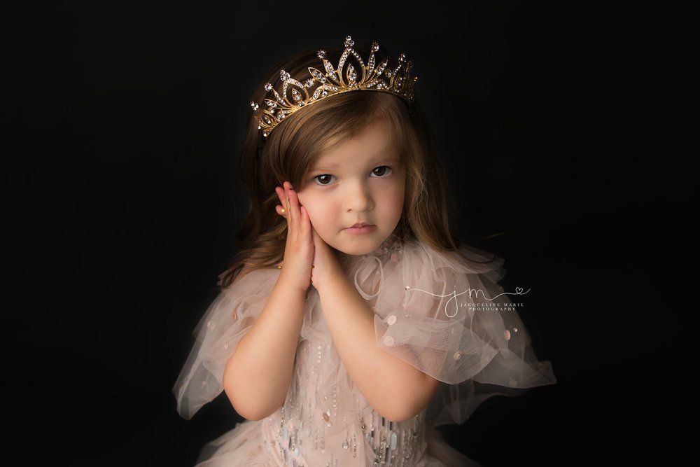 glitter photo session for three year old little girl wearing gold crown and pink tutu du monde dress in columbus ohio