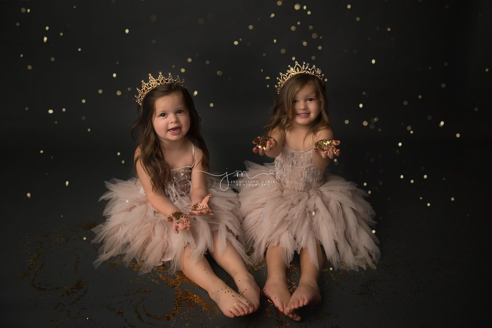 glitter photography for twin sisters wearing crowns and playing with gold glitter in columbus ohio