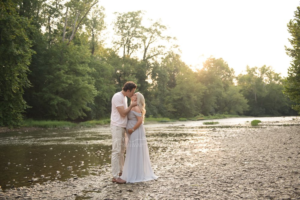 husband kisses wife during sunset maternity session in columbus ohio