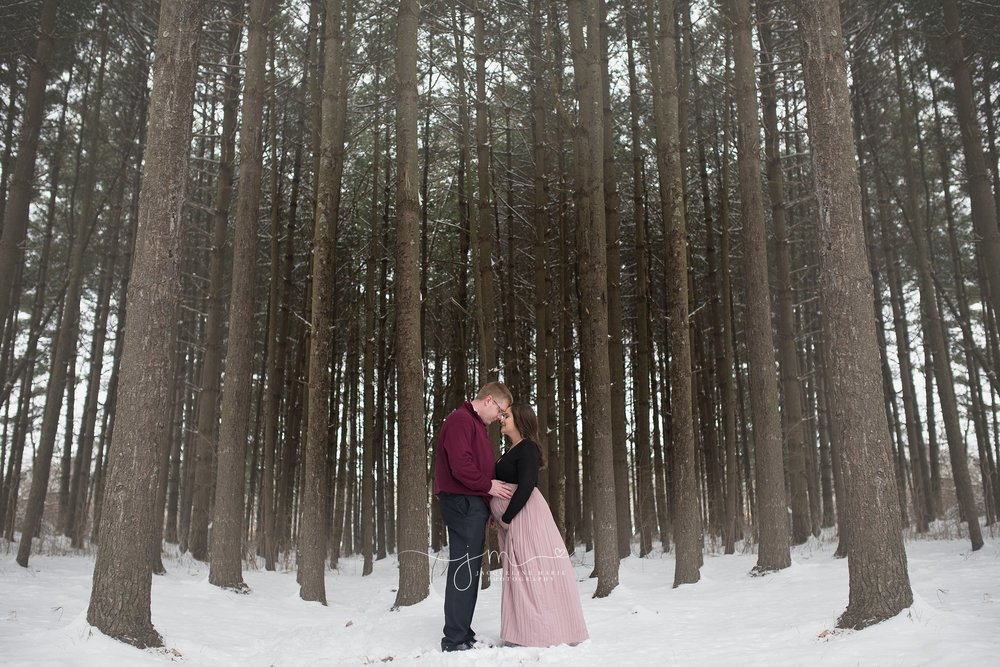 maternity session with mother and father in the snow in columbus ohio