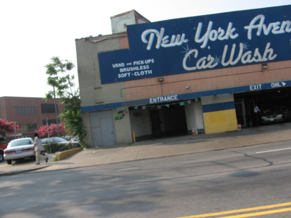 Car wash that used to be on NY Ave. They played Go-Go music really loud and danced. Sign was in silver sequins.