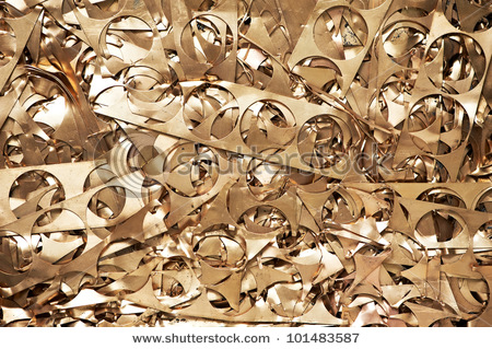 stock-photo-yellow-metal-brass-scrap-materials-recycling-backround-of-punching-waste-101483587.jpg
