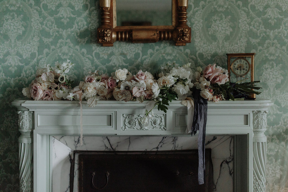 Wedding details and installations by Nectar & Root | Wedding floral design services in Burlington, Vermont (VT) | Mantel flower display with anemones, garden roses, blush