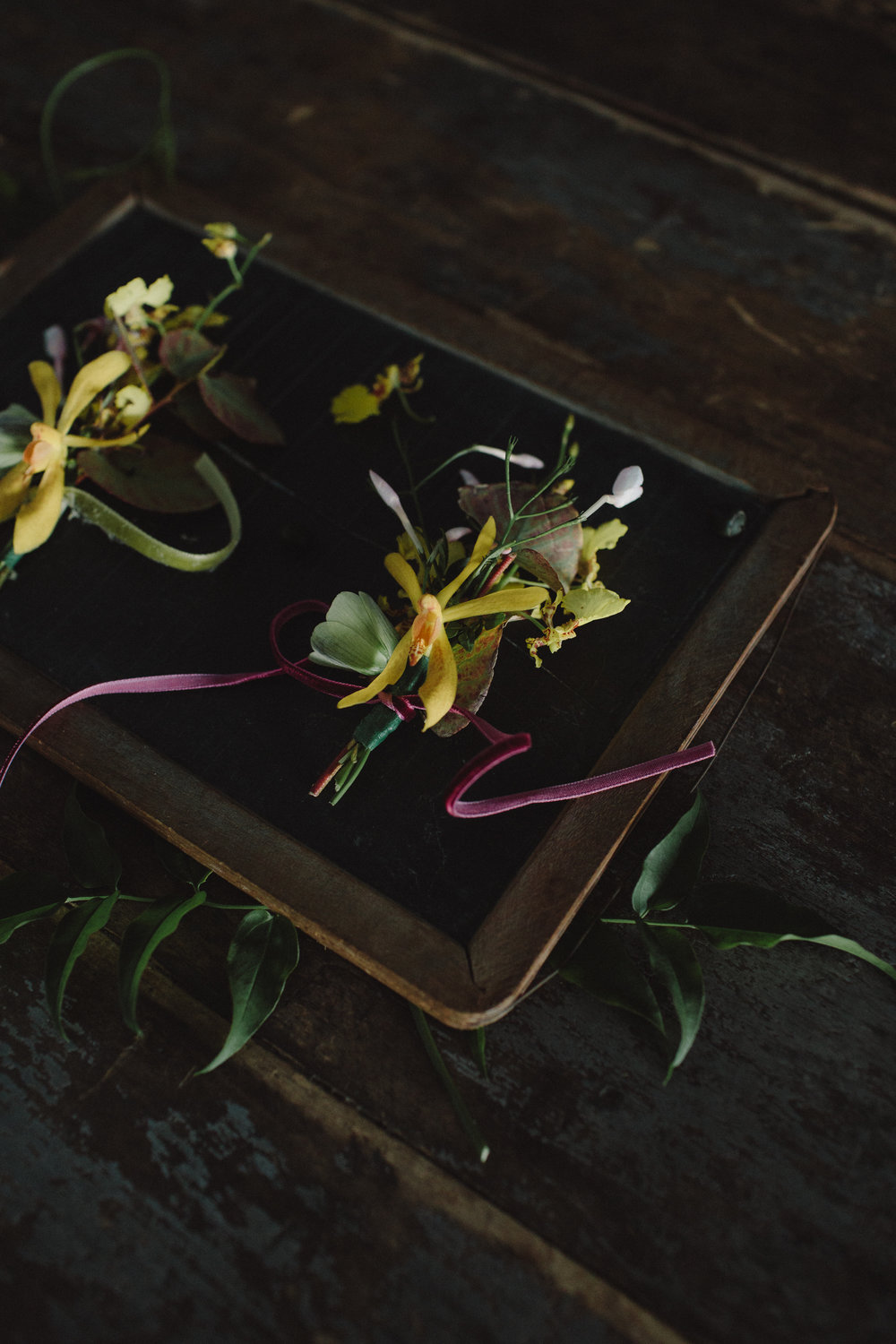 Spring wedding flowers by Nectar & Root | Wedding floral design services in Burlington, Vermont (VT) | Boutonnieres made with jasmine, orchids, and fritillaria buds