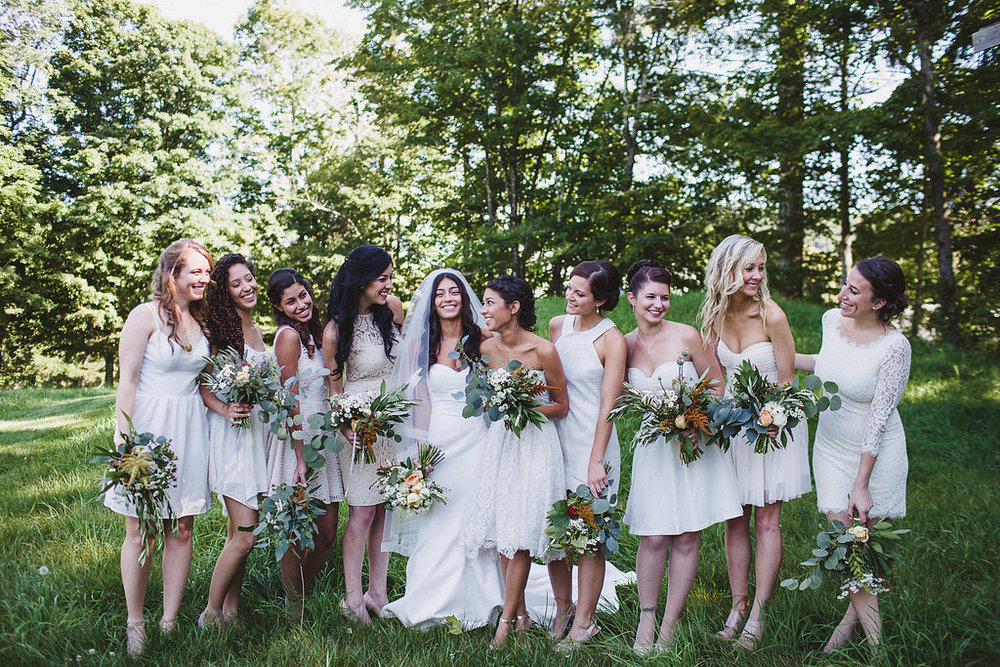 Summer wedding flowers by Nectar & Root | Wedding floral design services in Burlington, Vermont (VT) | Green, white, and peach bouquets of eucalyptus, garden roses