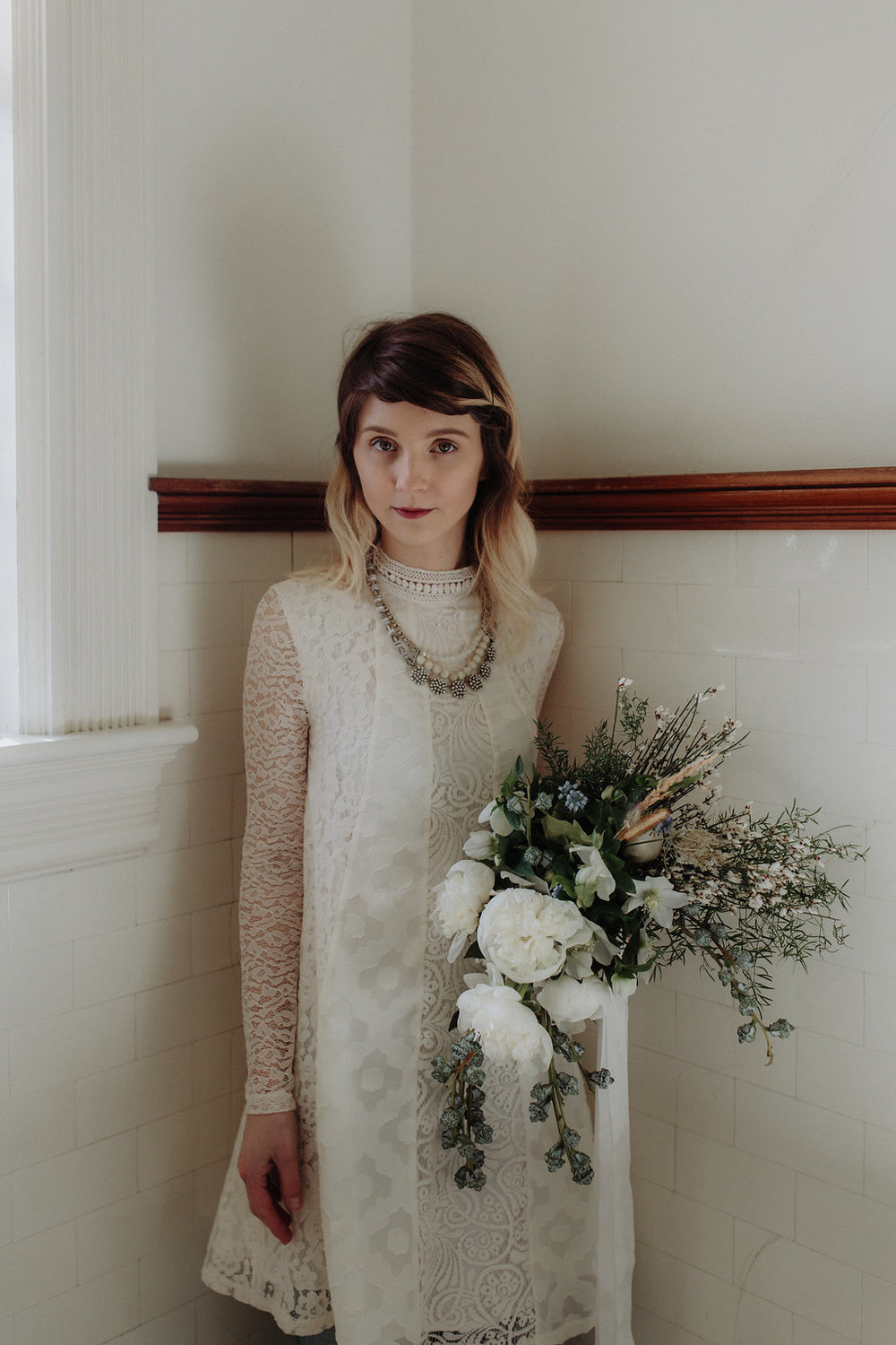 Winter wedding flowers by Nectar & Root | Wedding floral design services in Burlington, Vermont (VT) | Anthropologie wedding dress, green and white bridal bouquet