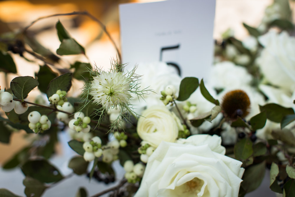 Winter wedding flowers by Nectar & Root | Wedding floral design services in Burlington, Vermont (VT) | Green and white centerpiece with garden roses, echinacea, nigella, berries