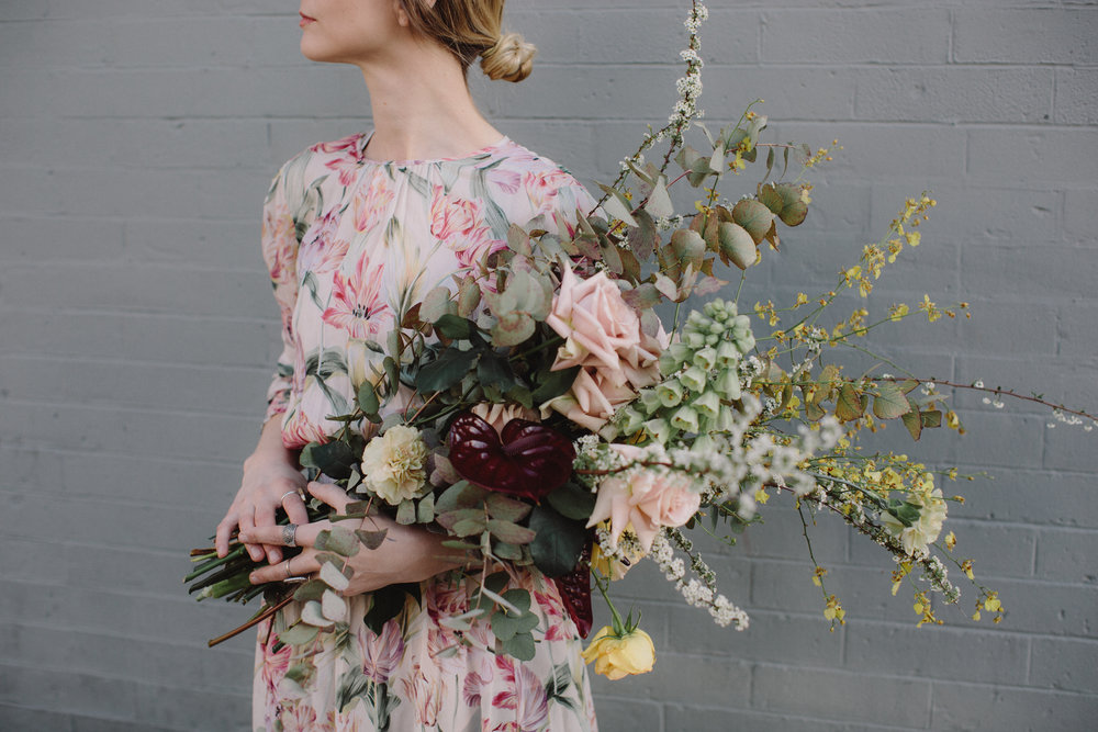 Spring wedding bouquet by Nectar & Root | Wedding floral design services in New England | Garden roses, eucalyptus, fritillaria, anthurium, carnations, orchids, spirea
