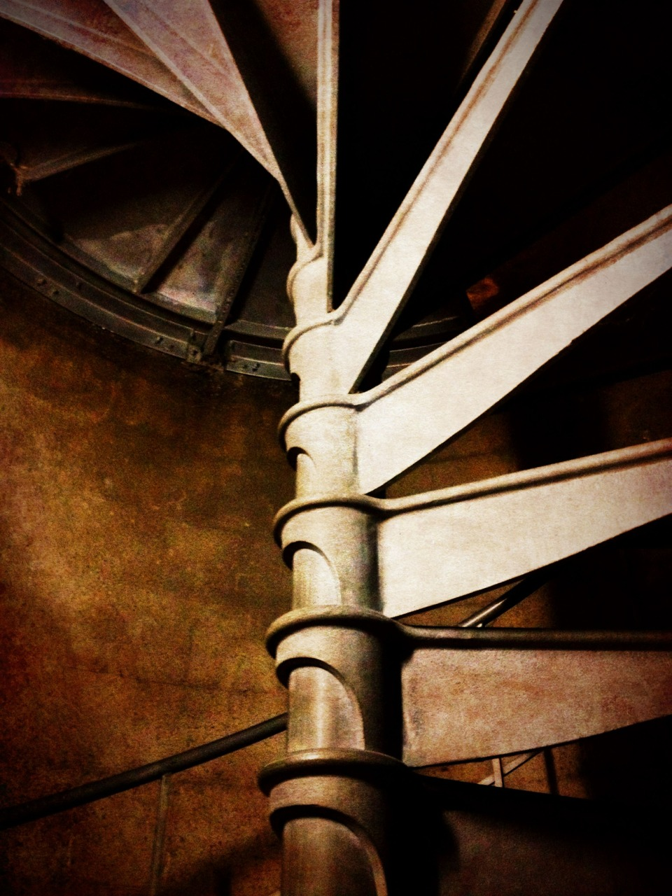 Up the spiral staircase.