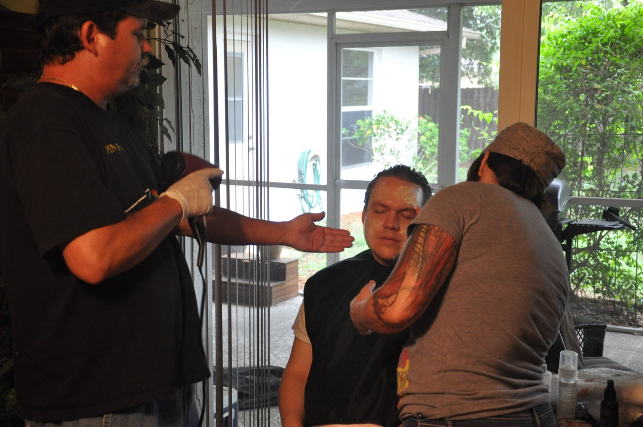 Our make-up effects crew, Greg Baker and Joannie Atkins, starting actor Chris Cline's transformation into zombie!Philip.