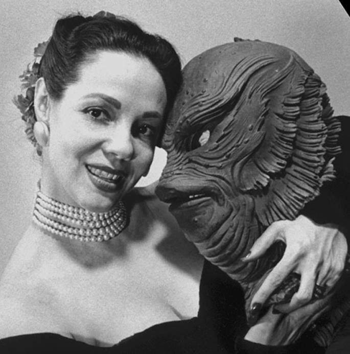 "arcaneimages :      Milicent Patrick holding the ""Creature"" mask she designed"