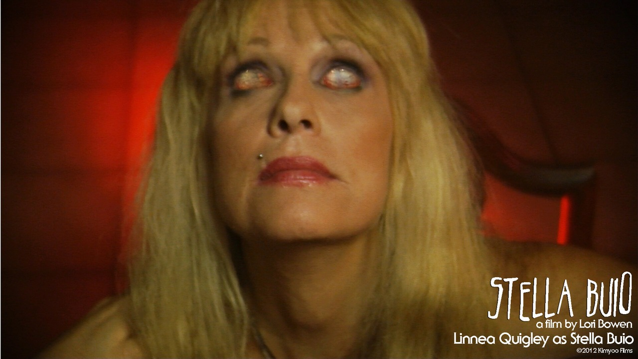 Today's screencap features the wonderful Linnea Quigley as the title character, Stella Buio. These are her real eyes, by the way. She has her normal going-out-in-public eyes and keeps these in her purse only to be used on special occasions.*   (* totally not true, she actually keeps them in a cooler.**)   (** also totally not true.)   I need more sleep.    To see our trailer, click here!
